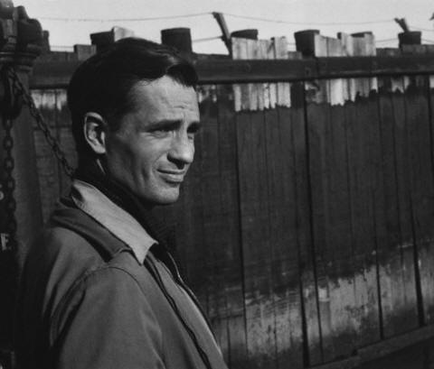 Jack Kerouac waits for a ferry at a dock in Staten Island 1965