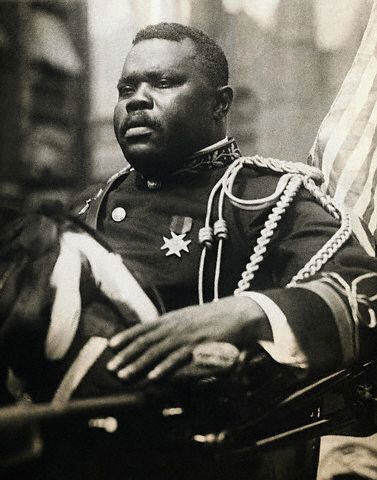 Marcus Garvey, riding in the giant parade through Harlem